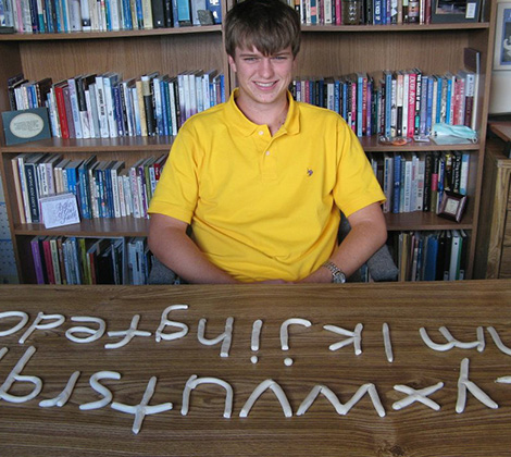Young Man With Clay Letters